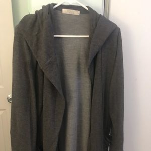 Woman's cardigan with pockets and hood